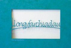 A laser cut card with the welsh word llongyfarchiadau