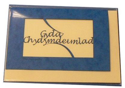 A laser cut card with the welsh word Gyda Chydymdeimlad