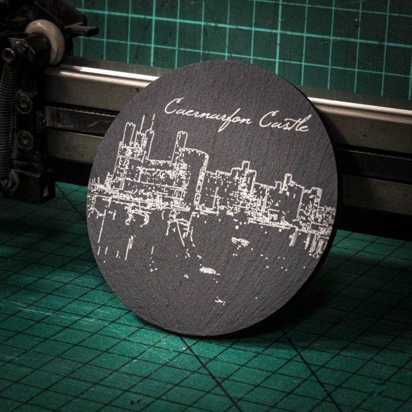 A laser engraved Welsh slate coaster with the image of Caernarfon Castles
