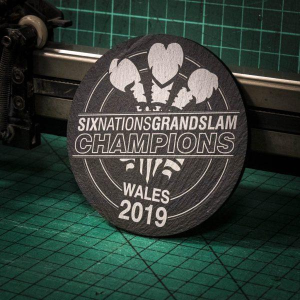 A laser engraved Welsh slate coaster depicting Wales six nation Grand Slam Victory