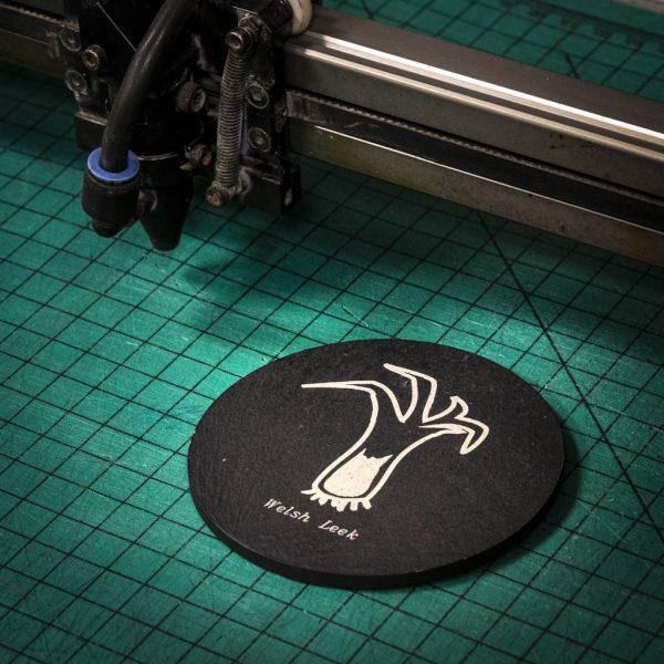 A laser engraved Welsh slate coaster with a welsh leek