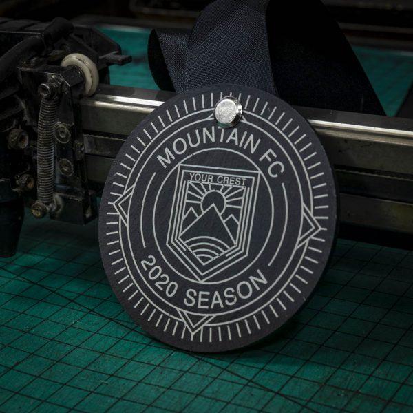 A personalised laser engraved Welsh slate running medal
