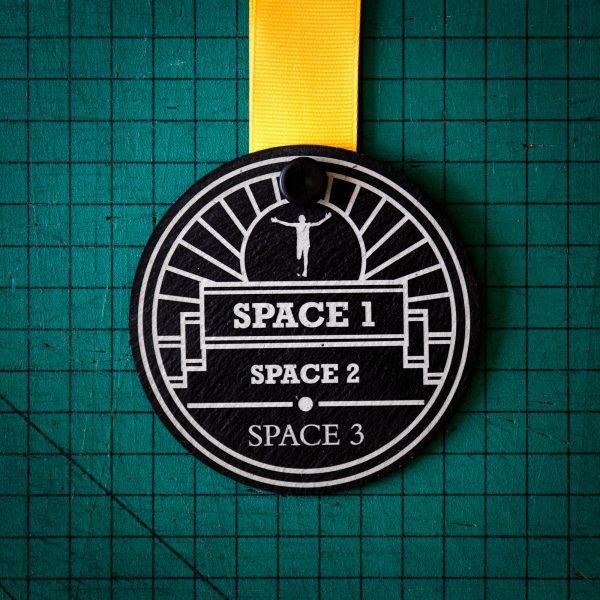 A personalised laser engraved Welsh slate sports medal