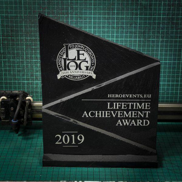 An extra large personalised laser engraved slate peak trophy