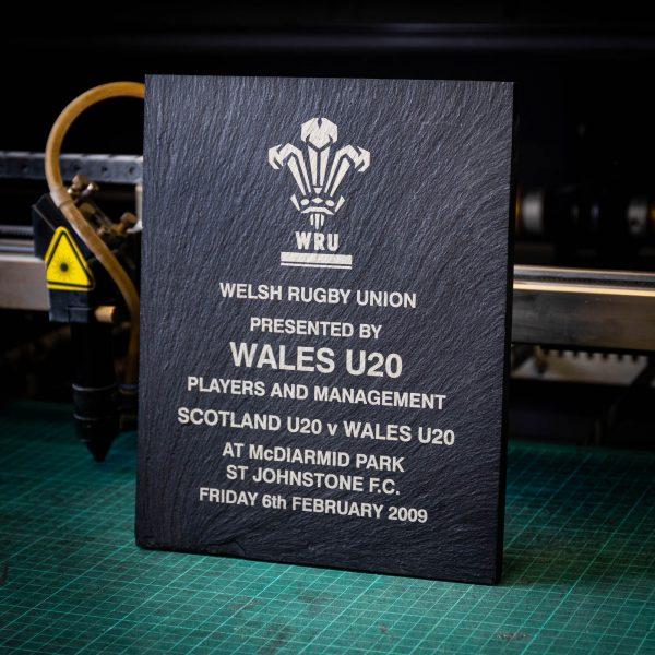 A large black laser engraved slate trophy