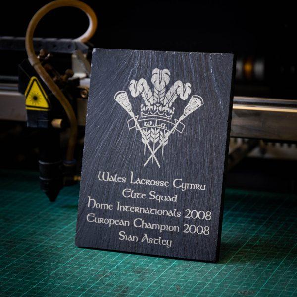 A medium black laser engraved slate trophy