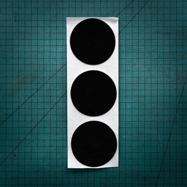 Black felt or baize circles laser cut to various sizes